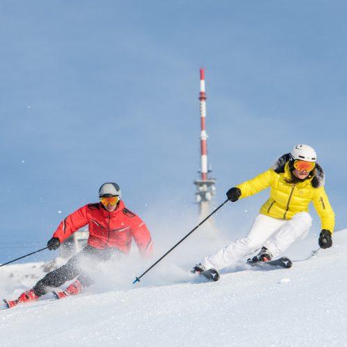 schnelles Skifahren Profis Paar Kitzbühel
